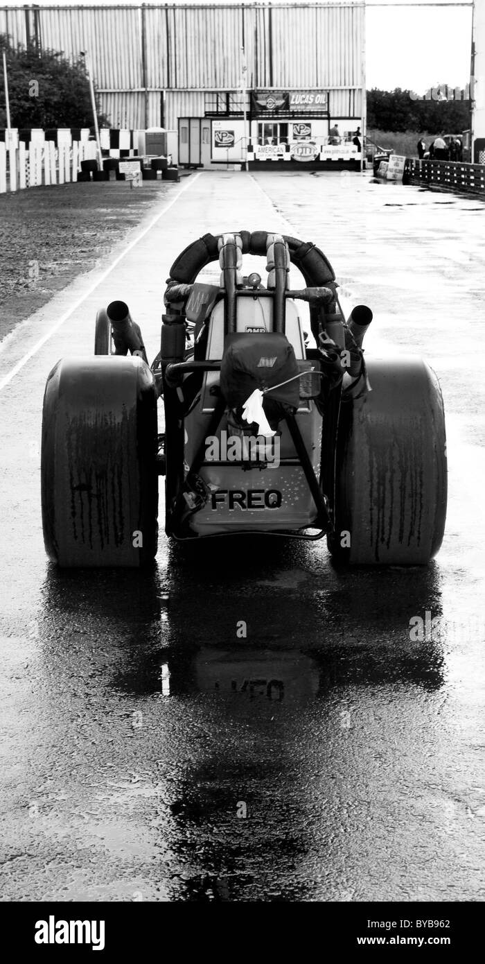 Rear view of drag racing car, rained off - Stock Image