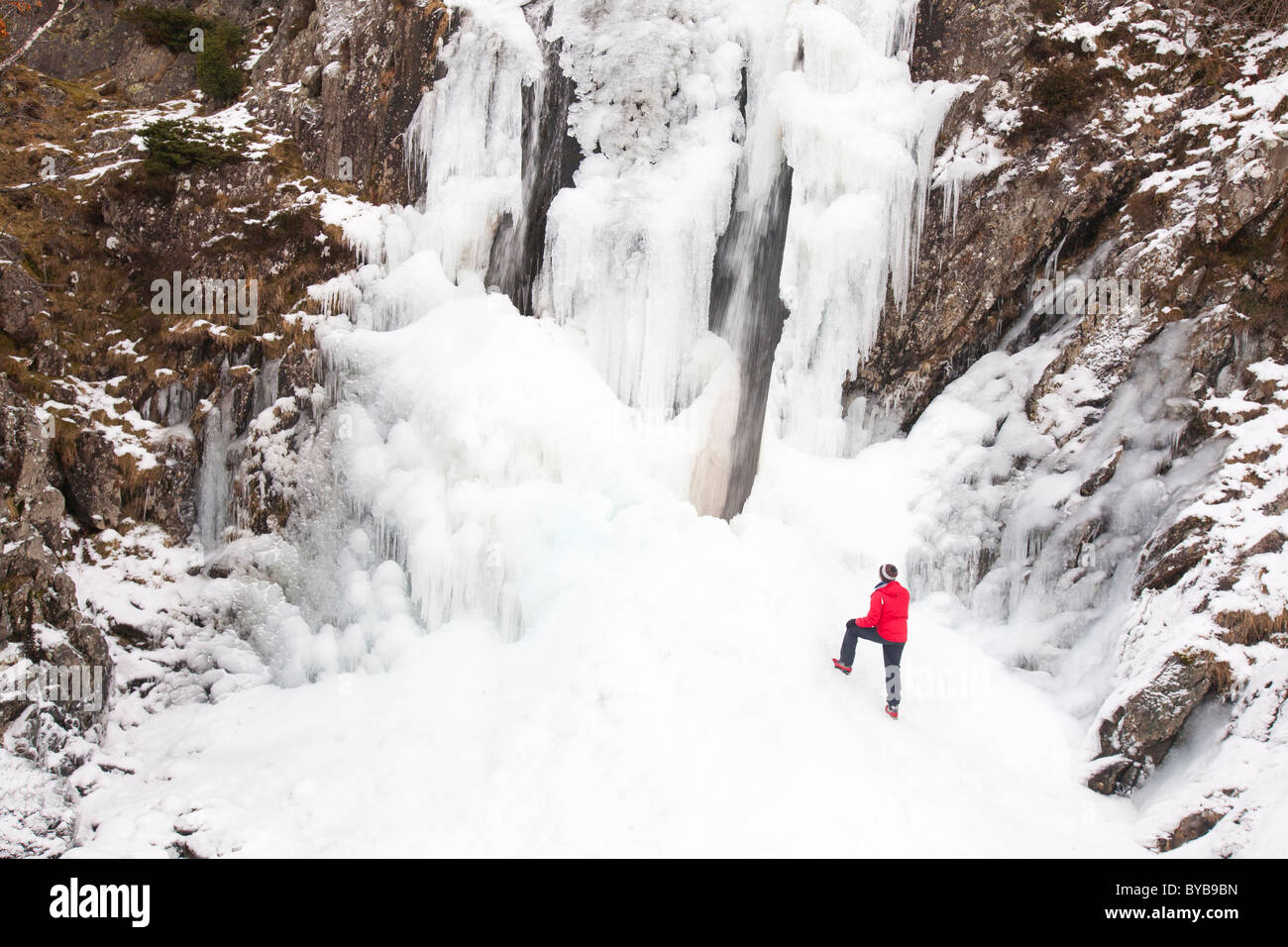 A climber in Fisher Place Ghyll in the Lake District frozen over during the December 2010 big chill. - Stock Image