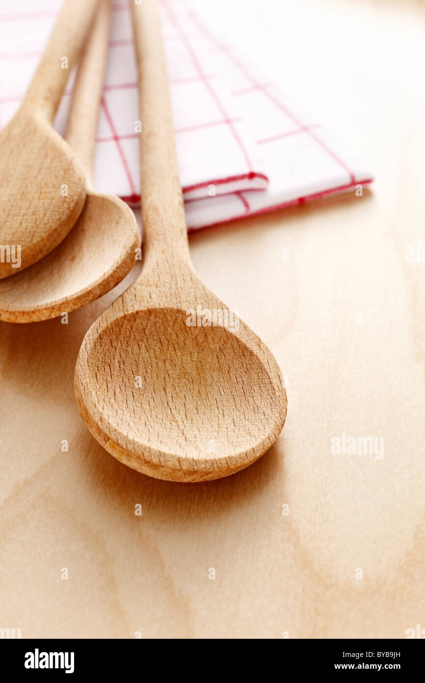 wooden spoon with tea towels Stock Photo