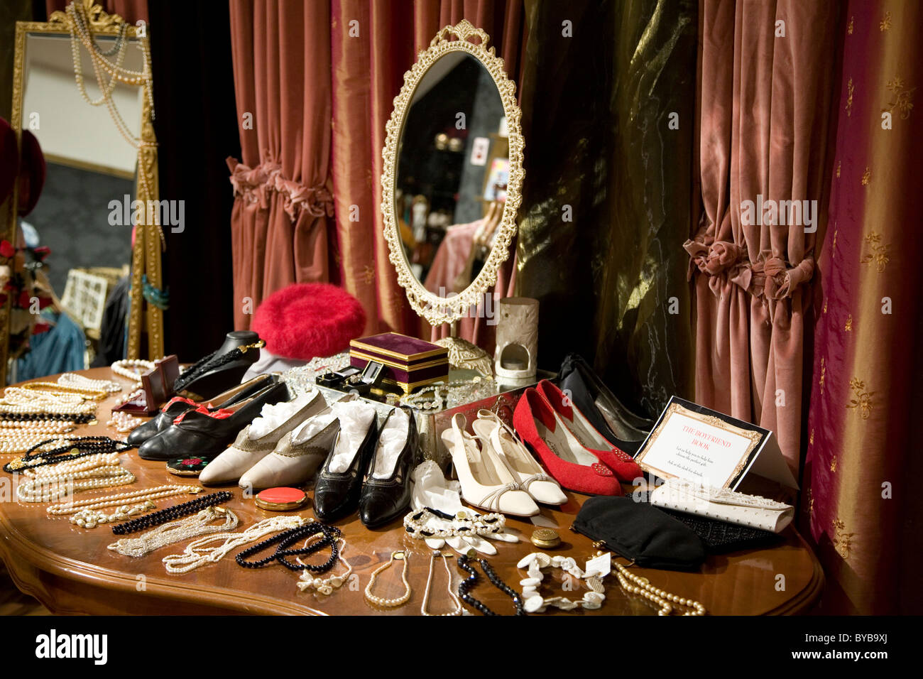 346cddeb5d6 Interior of a vintage clothing store with womens clothes and accessories