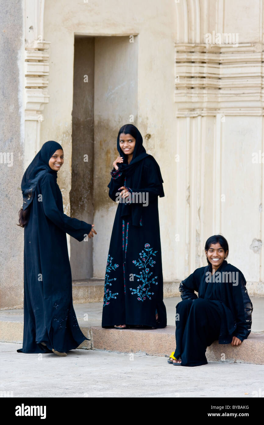 Young Muslim Women at Qutb Shahi Tombs in Golconda in Hyderabad India - Stock Image