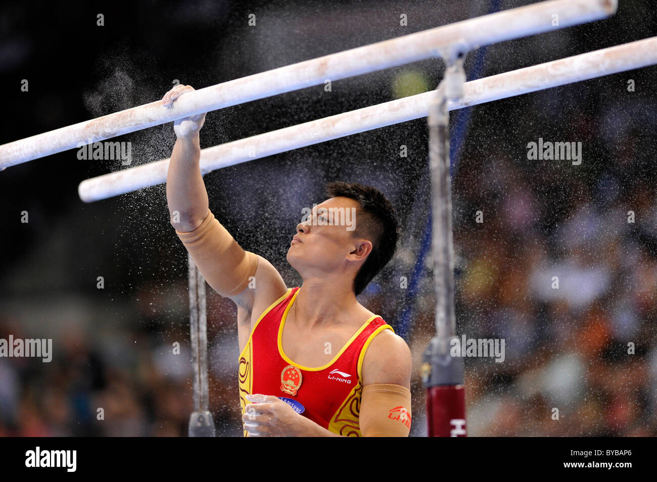 Guanyin Wang, CHN, preparing the parallel bars with magnesia, EnBW Gymnastics World Cup 2010, 28th DTB-Cup, Stuttgart Stock Photo