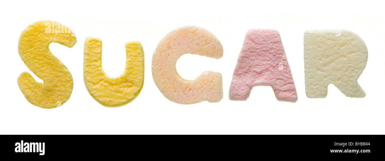 Studio shot on white background of sweet letters -spelling out the word Sugar - Stock Image