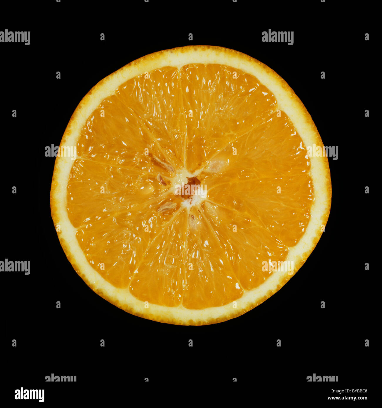 Cut section of a citrus fruit orange variety Pera - Stock Image