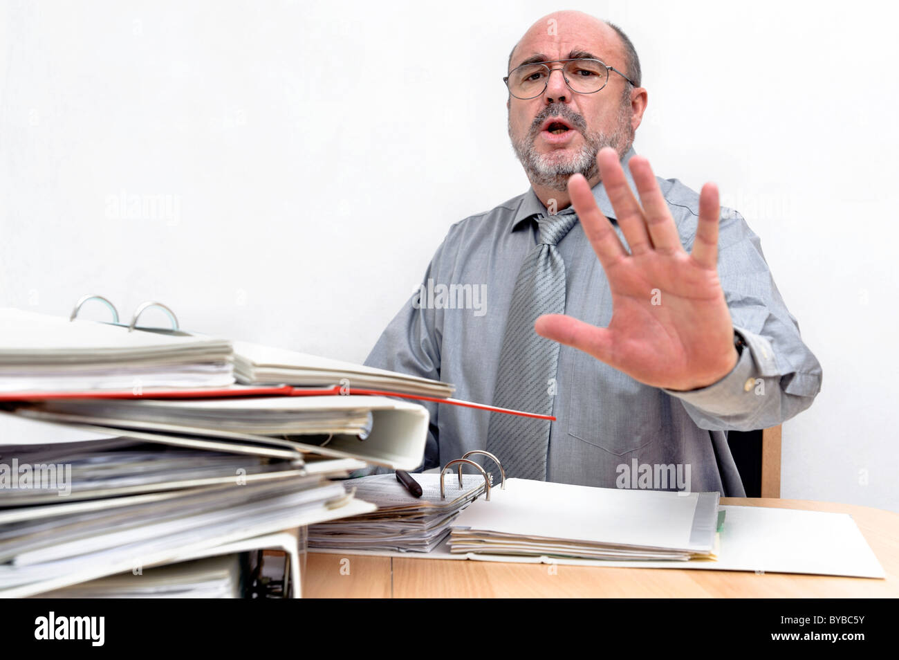 A clerk making a negative gesture - Stock Image