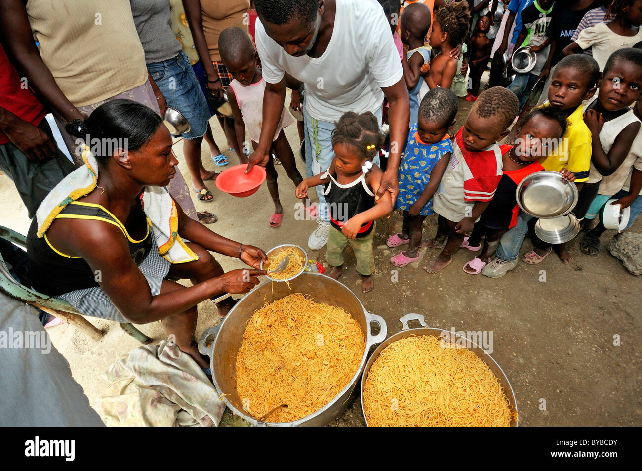 Food distribution to needy children at a camp for victims of the January 2010 earthquake, Croix-des-Bouquets district, - Stock Image