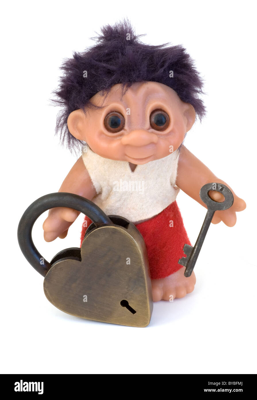 Troll boy in red and white holding a large heart lock and key - Stock Image