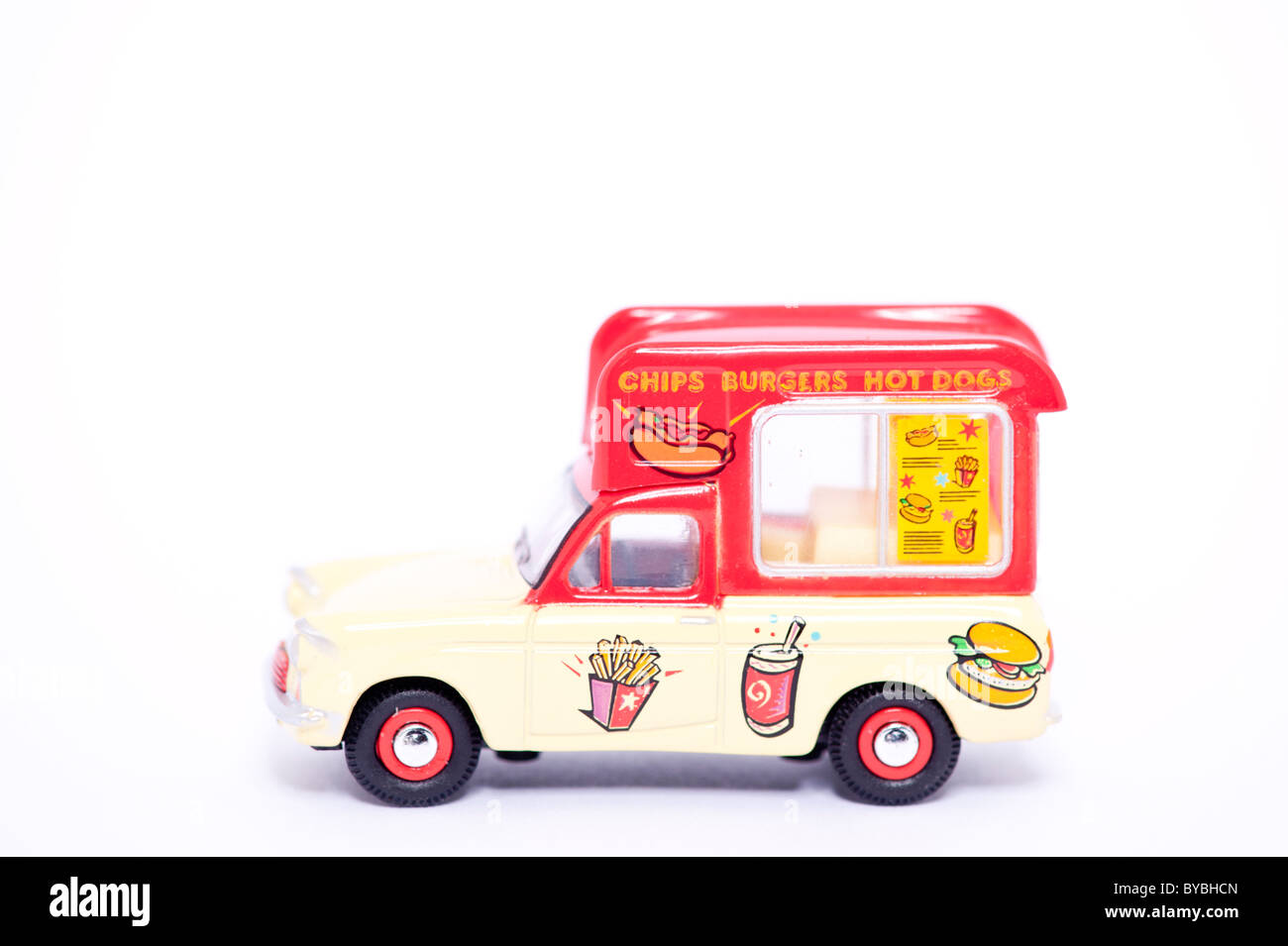 A toy model chips , burgers and hot dogs van on a white background - Stock Image