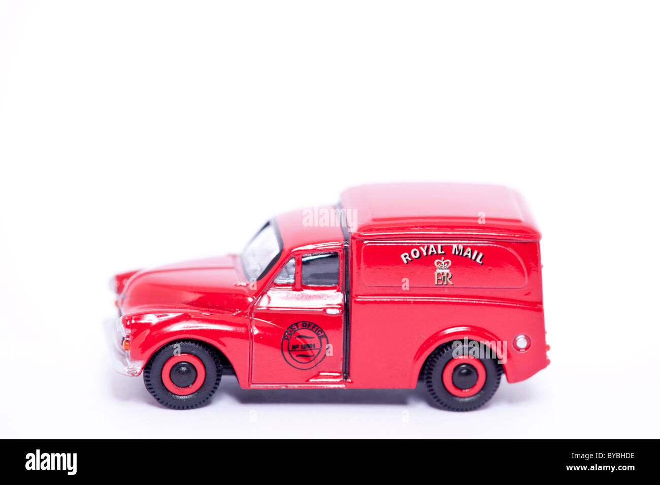 A toy model old fashioned Royal Mail post van on a white background - Stock Image