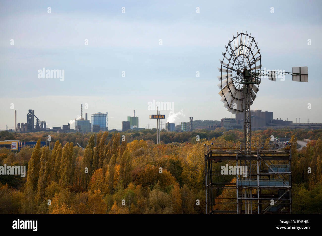 View over a windmill and the Ruhr Area from Duisburg-Nord Landscape Park, Duisburg, Ruhr Area, North Rhine-Westphalia - Stock Image