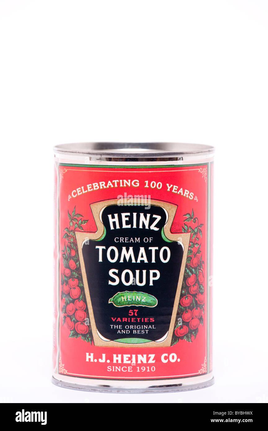 A tin of Heinz cream of tomato soup on a white background - Stock Image