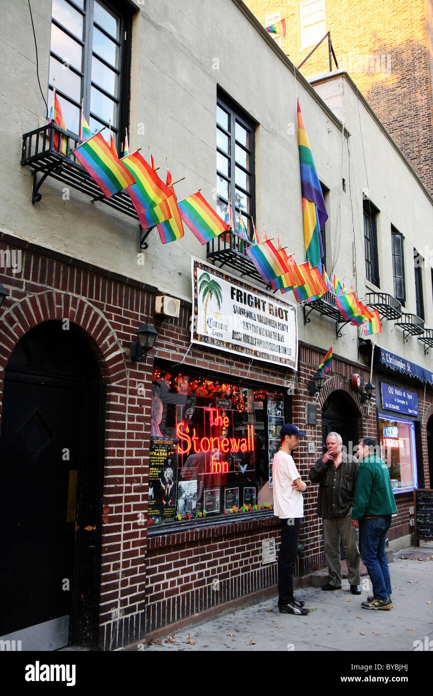 LGBT rainbow flags above the famous Stonewall bar in Greenwich Village in New York City, USA - Stock Image