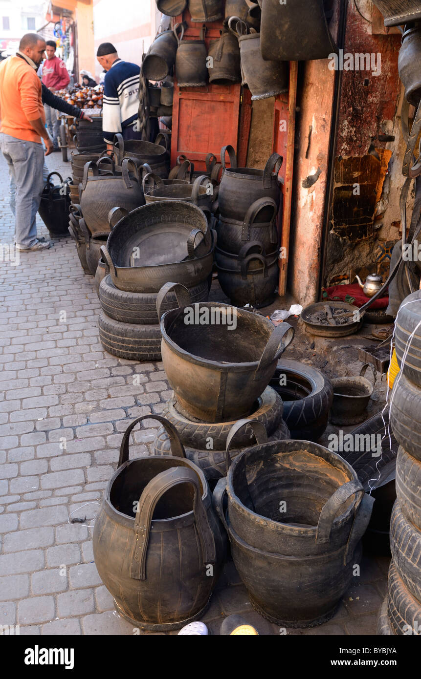 Shop selling containers made of reused rubber tires in the souk Medina market of Marrakesh Morocco - Stock Image