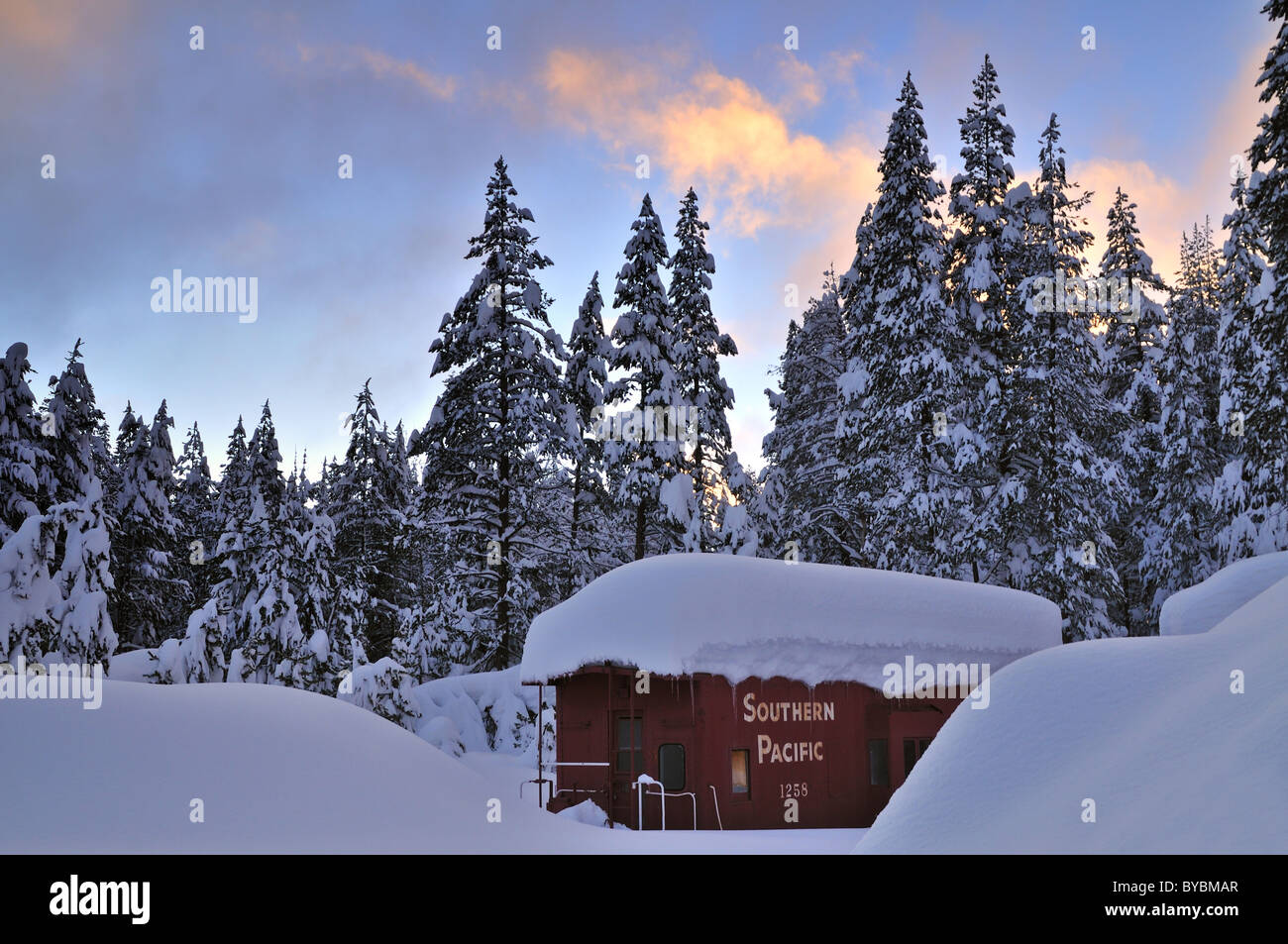 old railroad car in the snowy forest near Donner Summit - Stock Image