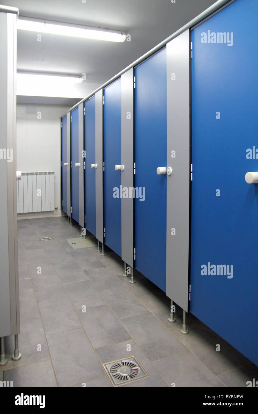 bathroom corridor doors blue pattern indoor toilette - Stock Image