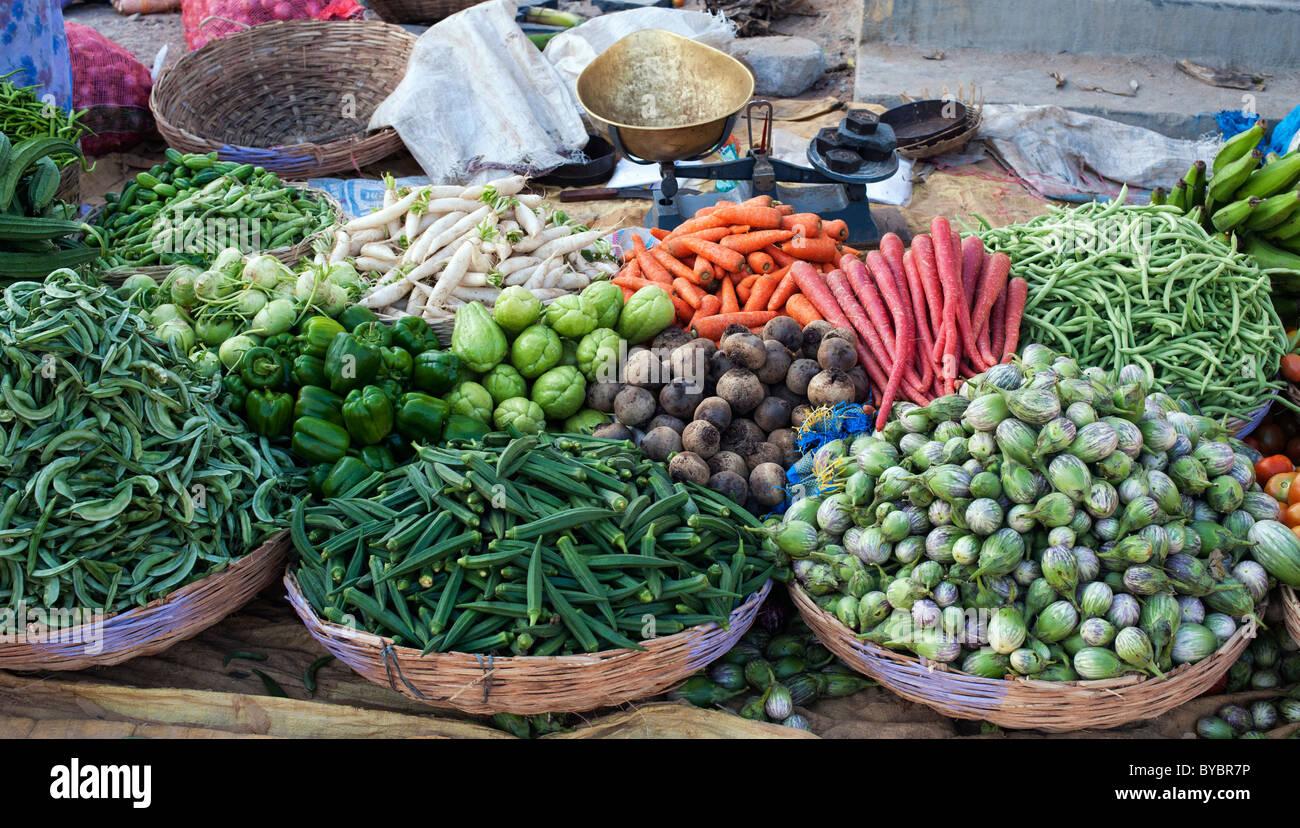 Indian vegetables in baskets at a rural village market, Andhra Pradesh, India. - Stock Image