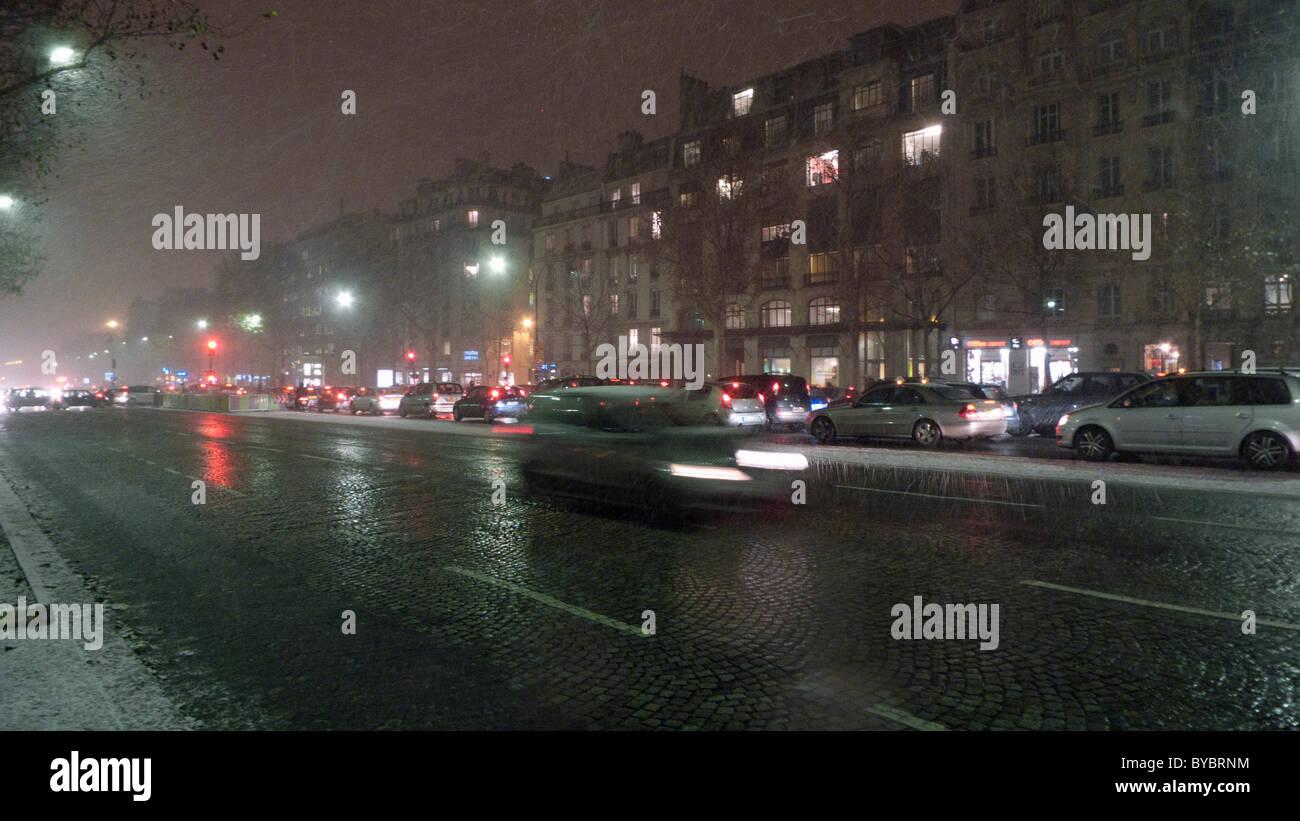 Avenue de la Grande Armée during downpour of sleet Paris France - Stock Image