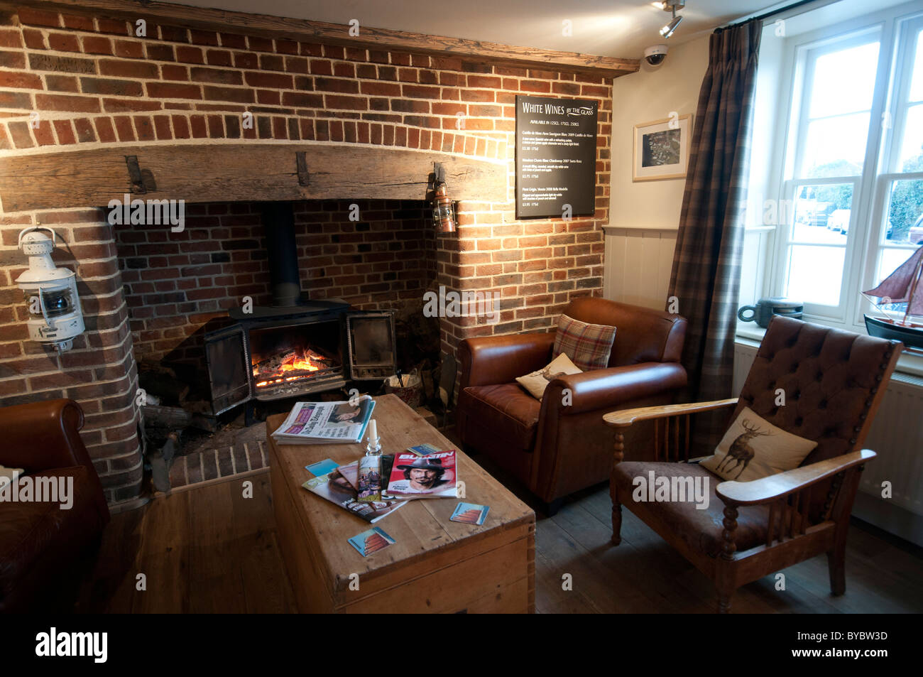 by the Fireside at the Ship Inn Public house in Conyer Kent England UK - Stock Image