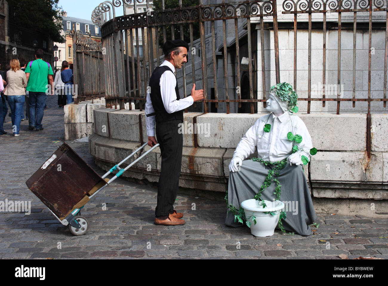 Two street entertainers talking. Montmartre, Paris. - Stock Image