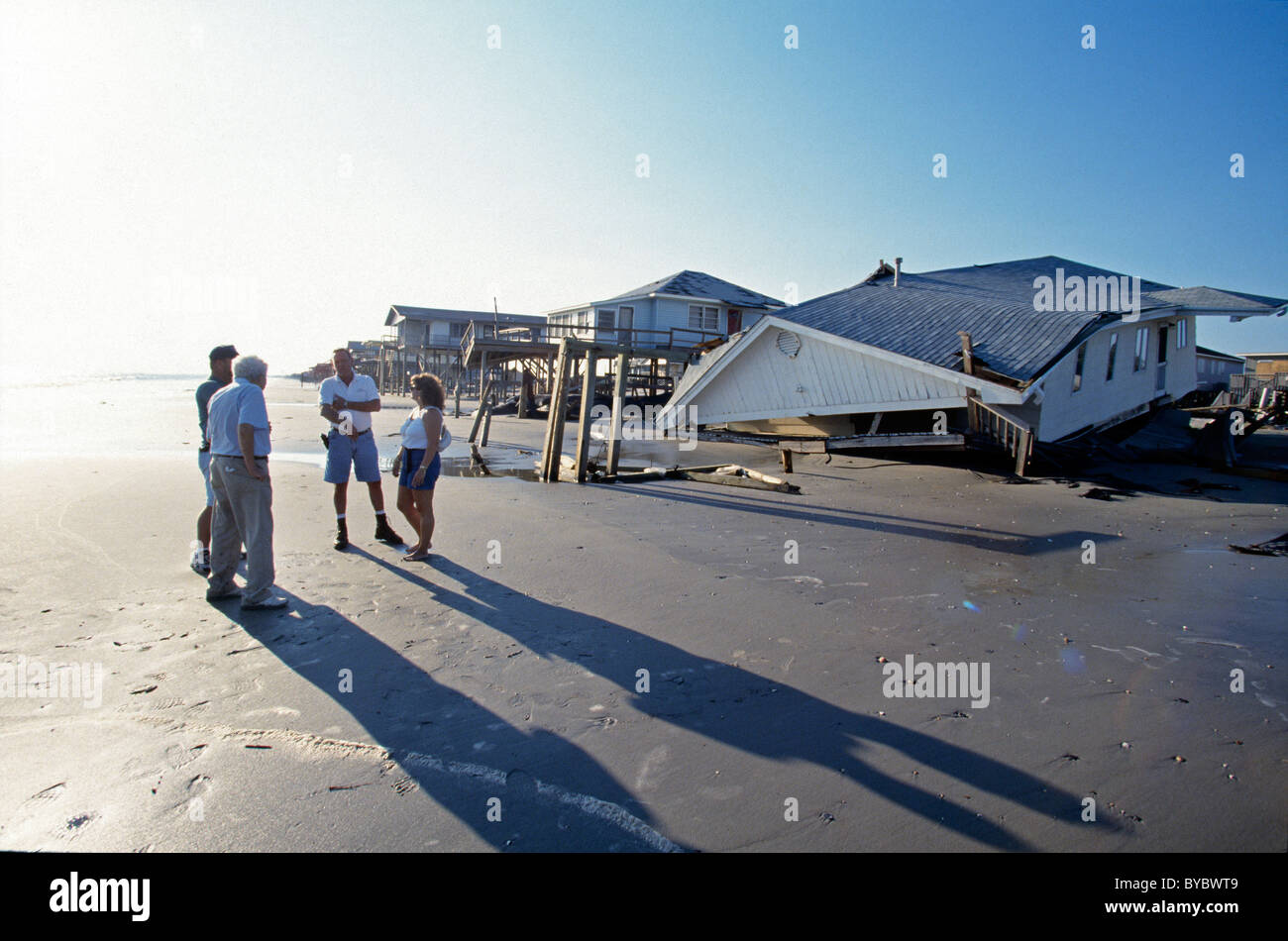 Local residents gather and speak about the destruction caused by Hurricane Floyd along the coast of Oak Island, - Stock Image