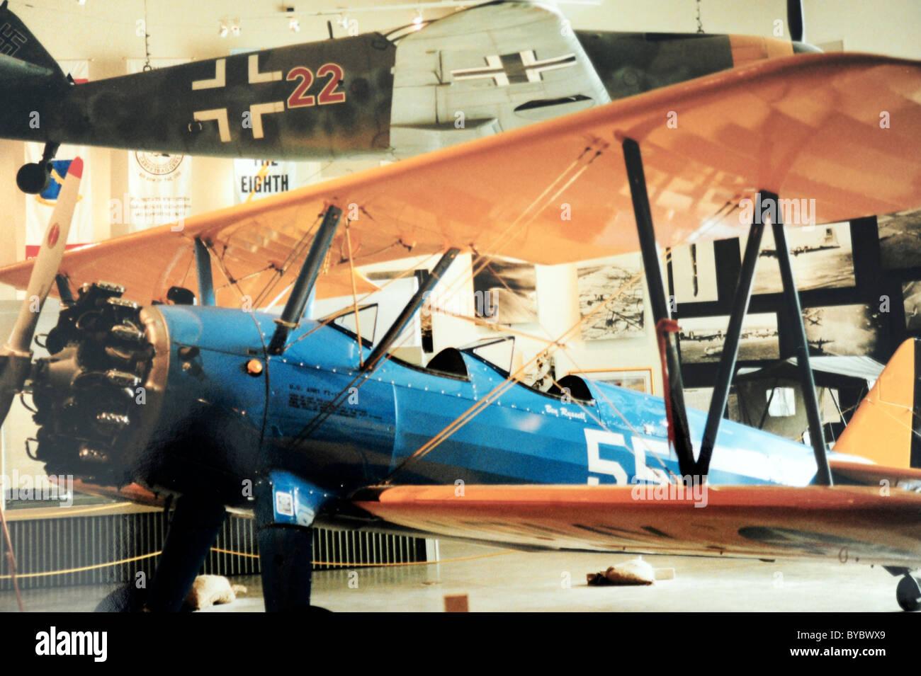 US Air Force biplane trainer WW II & German Messerschmitt fighter - Stock Image