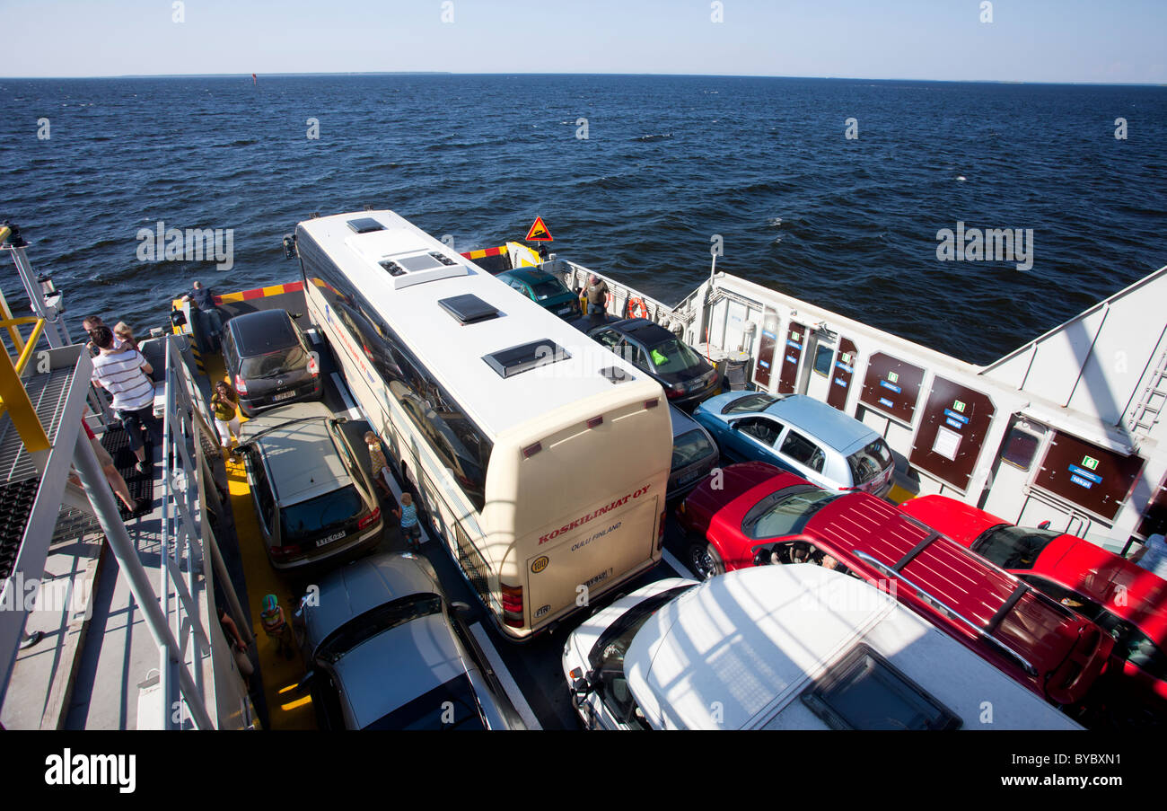 Cars , bus and people on a ferryboat at sea , Finland - Stock Image