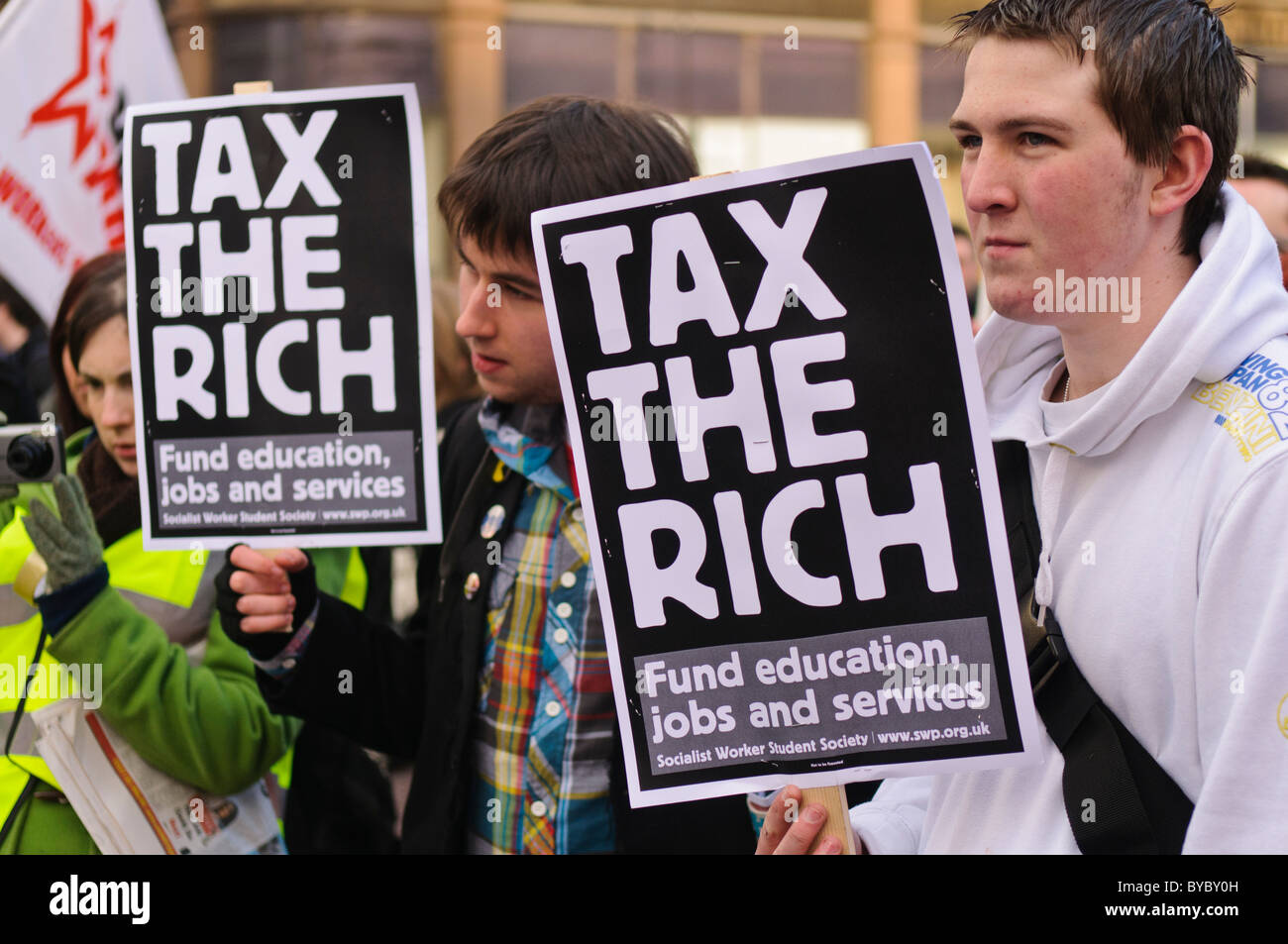 Students protest against university funding cuts and hold placards saying 'Tax the rich. Fund education, jobs - Stock Image