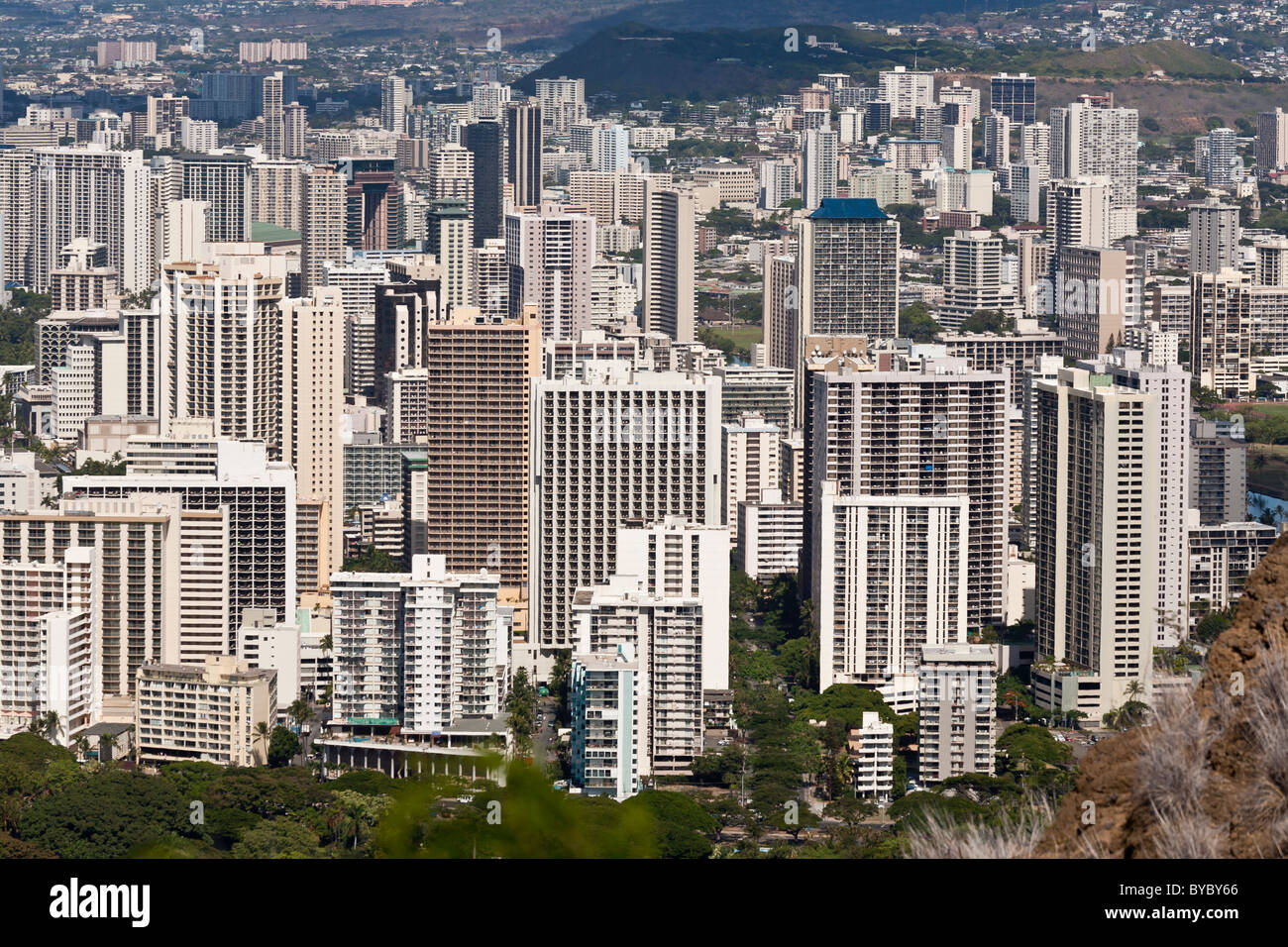 Skyscrapers of Waikiki. Tall buildings dominate the Waikiki skyline in this view from atop the Diamond Head crater. - Stock Image