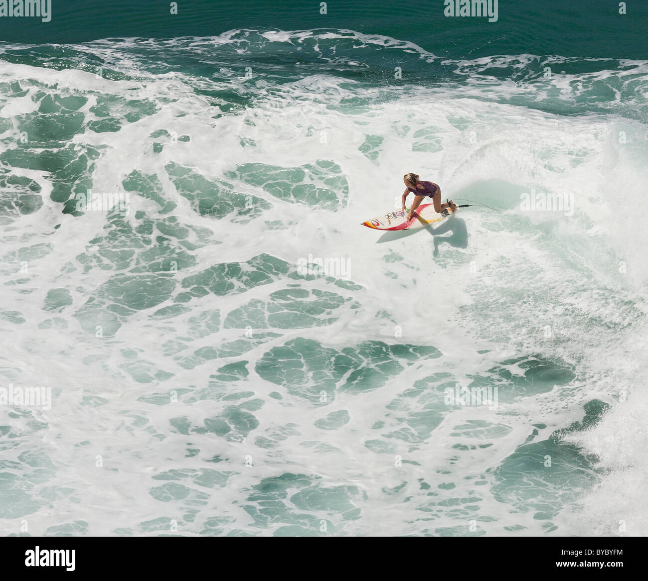 Soul Surfer Bethany Hamilton cuts through a breaking wave. - Stock Image