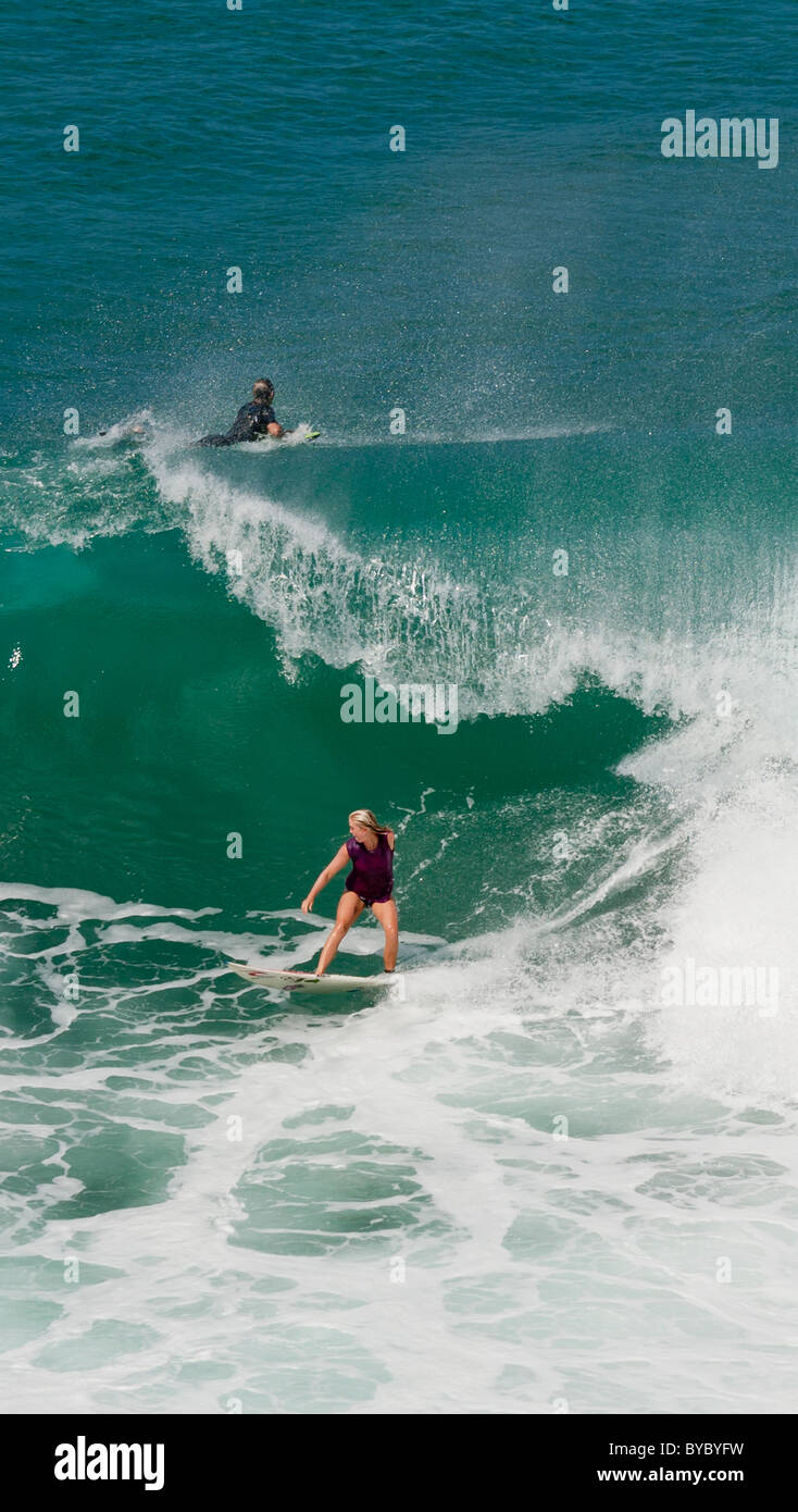 Soul Surfer Bethany Hamilton slips under a curling wave. - Stock Image
