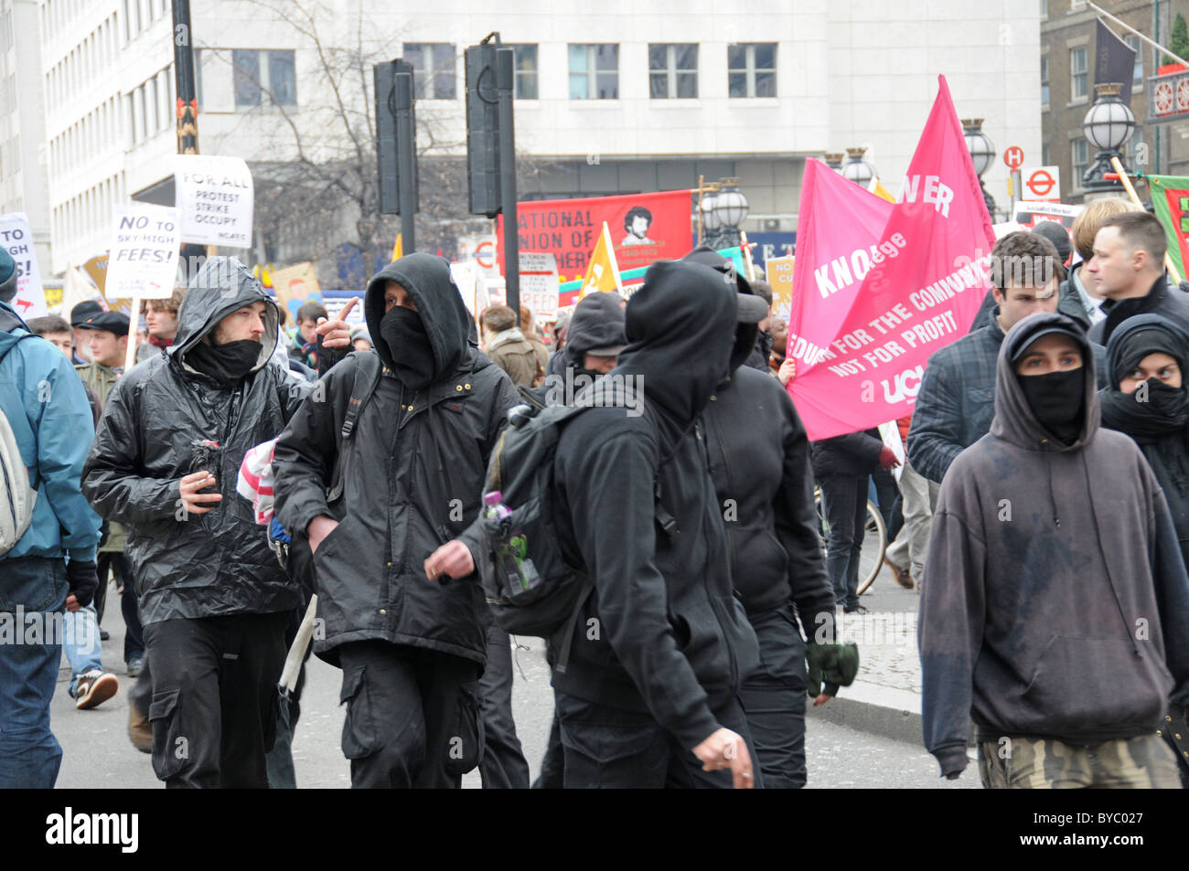 NUS TUC Balaclava and masked protesters Student and Union protest against tuition fees and job losses - Stock Image