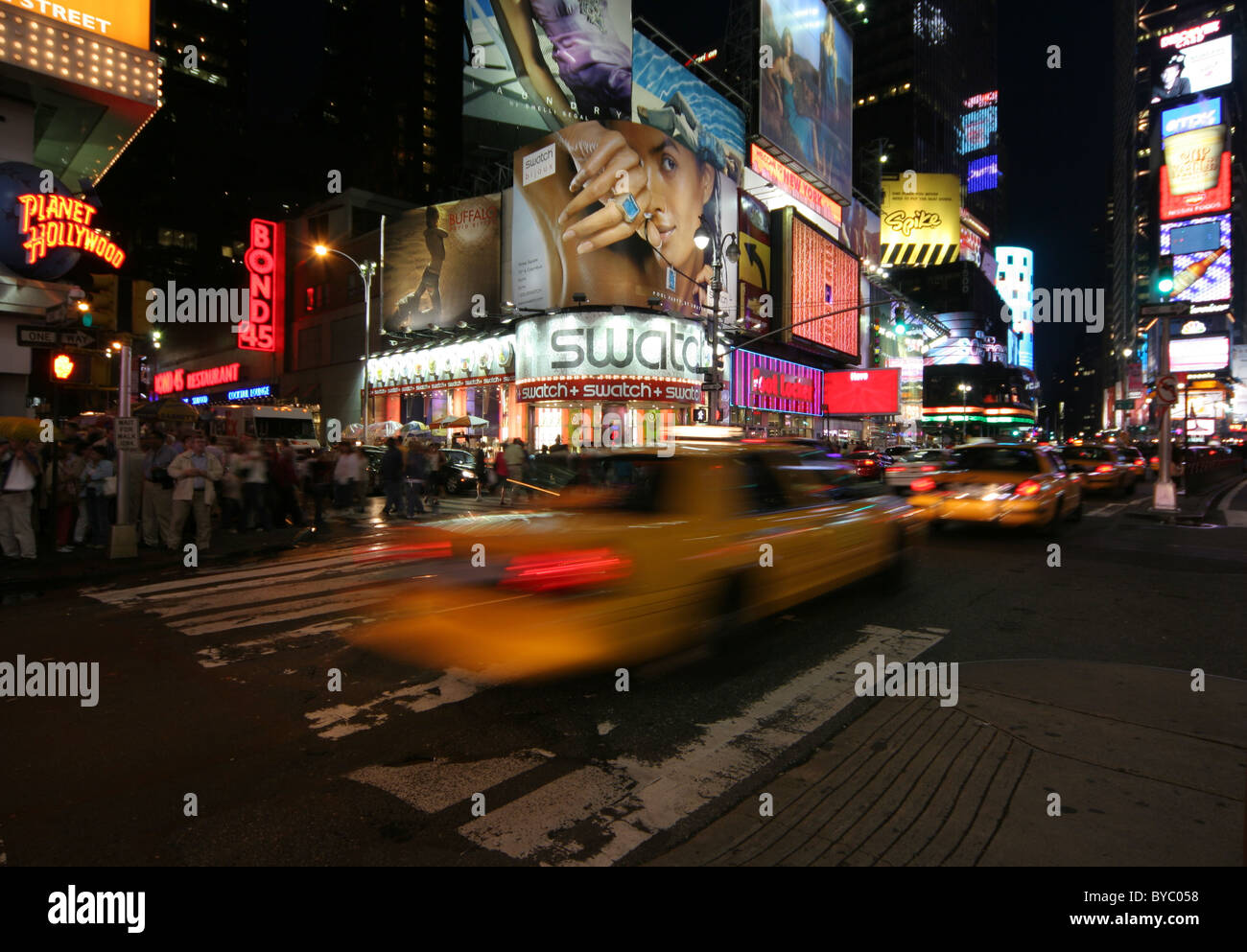moving yellow cab in times square Stock Photo