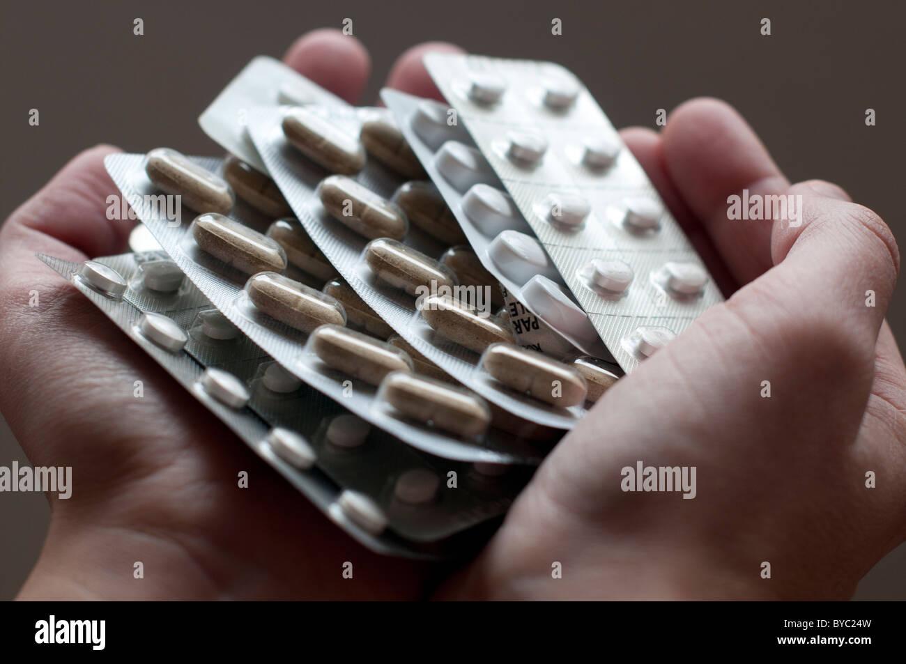 hands holding prescription  pills - Stock Image