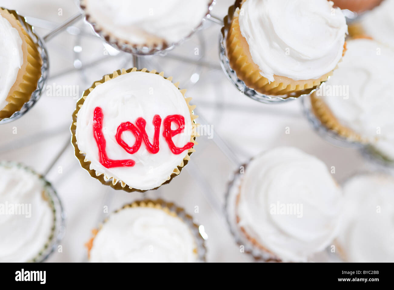 Cupcakes in holder with Love written on top - Stock Image