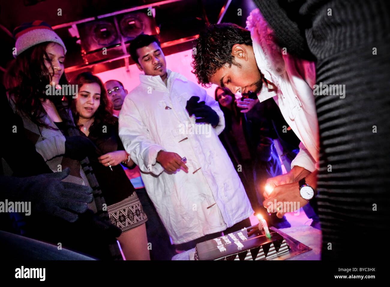 A Bartender Cuts A Birthday Cake At The Nightclub 21 Fahrenheit