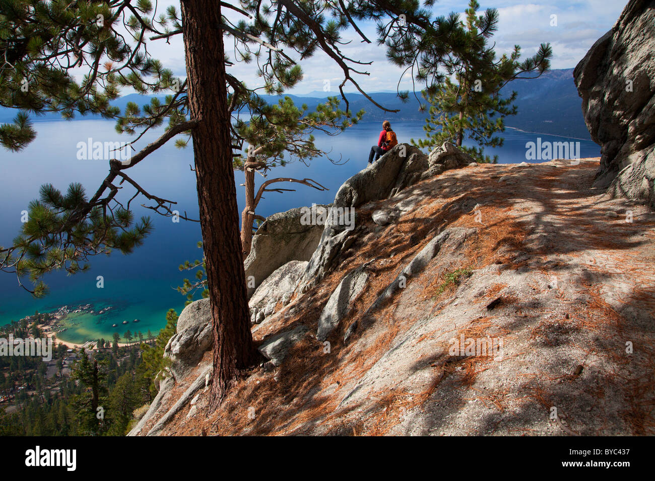 A hiker enjoys the view along the Flume Trail, Lake Tahoe, NV (model released) - Stock Image