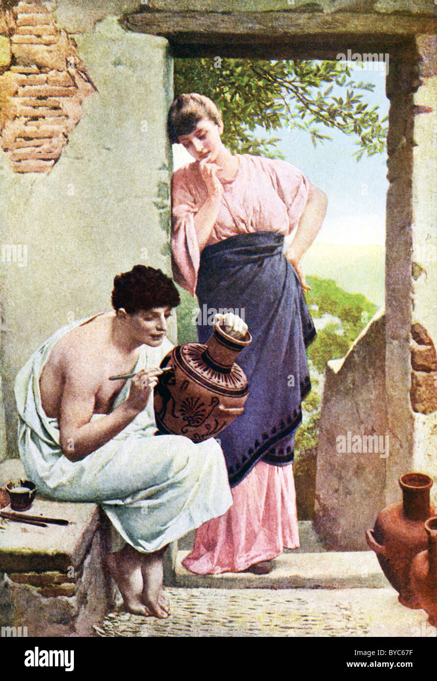 A young Greek maiden watches a Greek artisan decorate a large earthenware container. - Stock Image