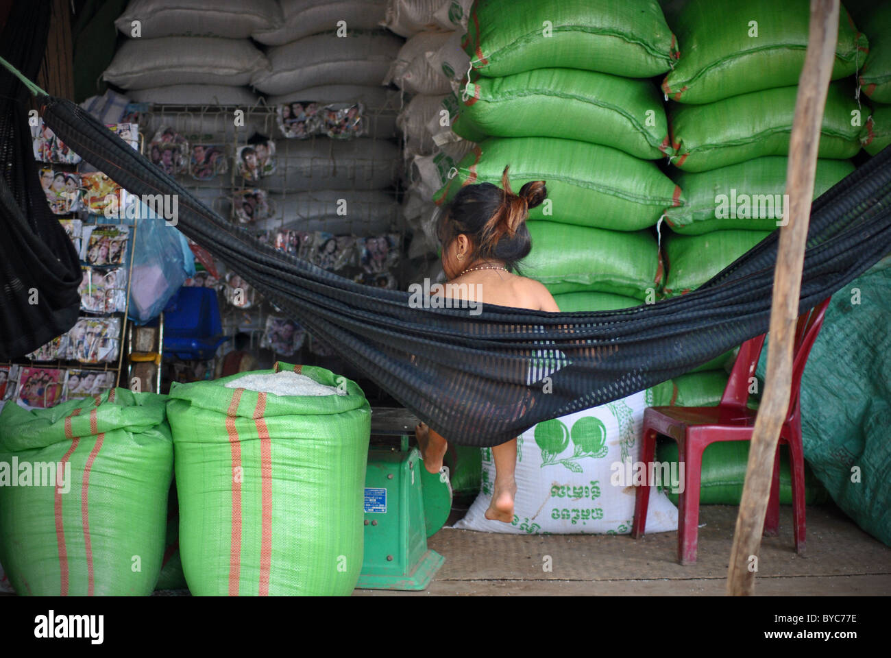 Sacks of rice in a shop in Kompong Khleang, Cambodia Stock Photo