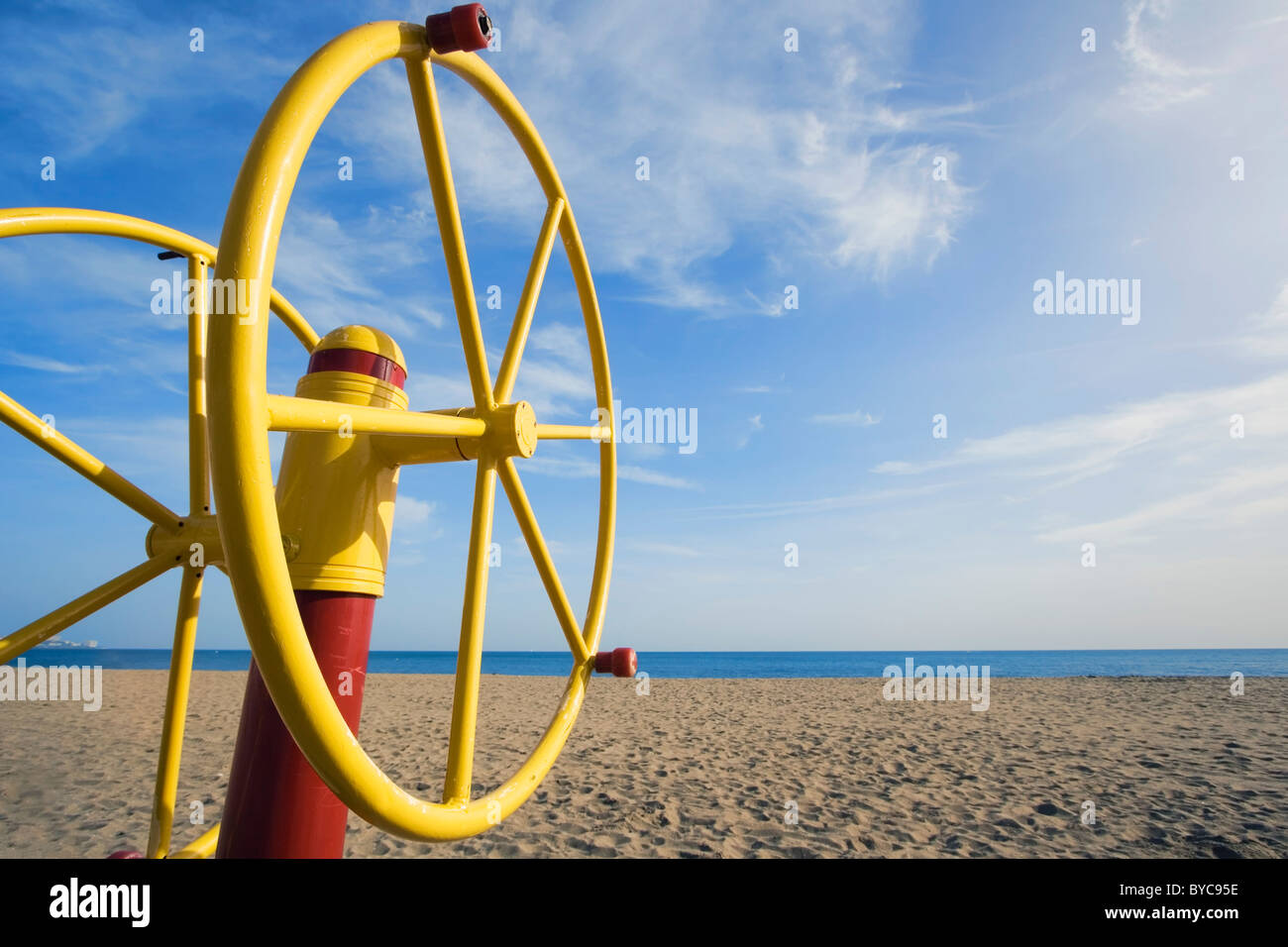 Arm excercise machine on empty beach in Los Boliches, Fuengirola, Costa del Sol, Spain. - Stock Image