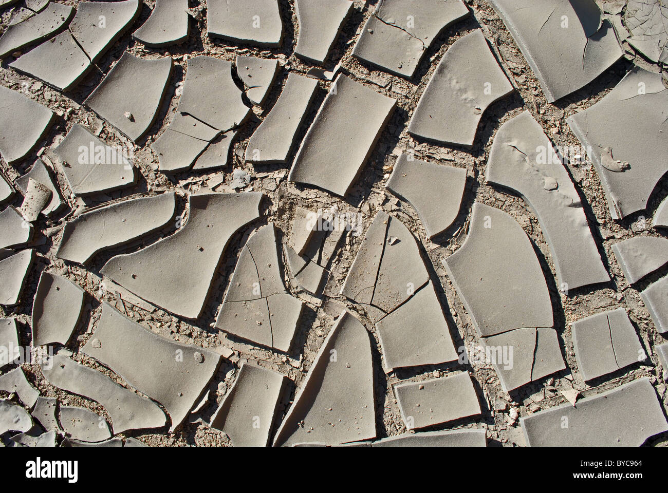 Dry cracked earth in Tunisia - Stock Image