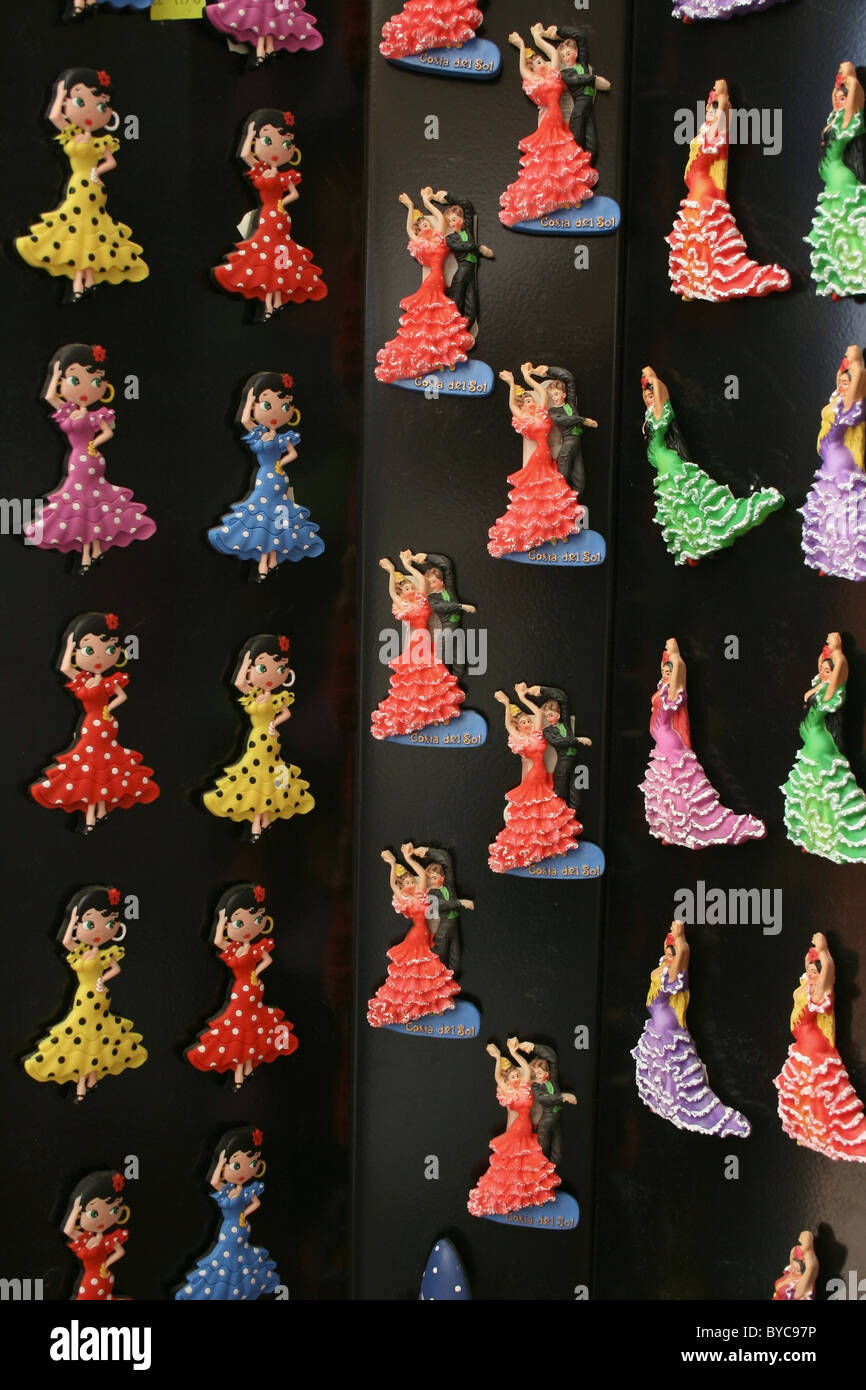 Fridge magnets in the form of Spanish dancers for sale outside souvenir shop in Los Boliches, Fuengirola, Costa Stock Photo