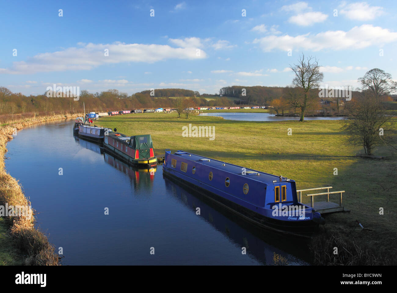 Barges moored on the Ashby canal at Shackerstone in Leicestershire - Stock Image