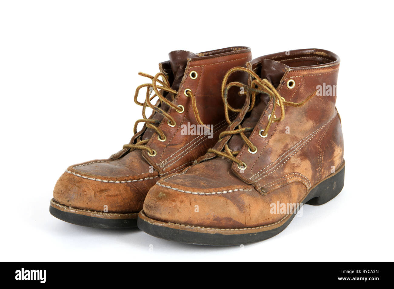 Pair of old steel toed shoes in very used condition. - Stock Image