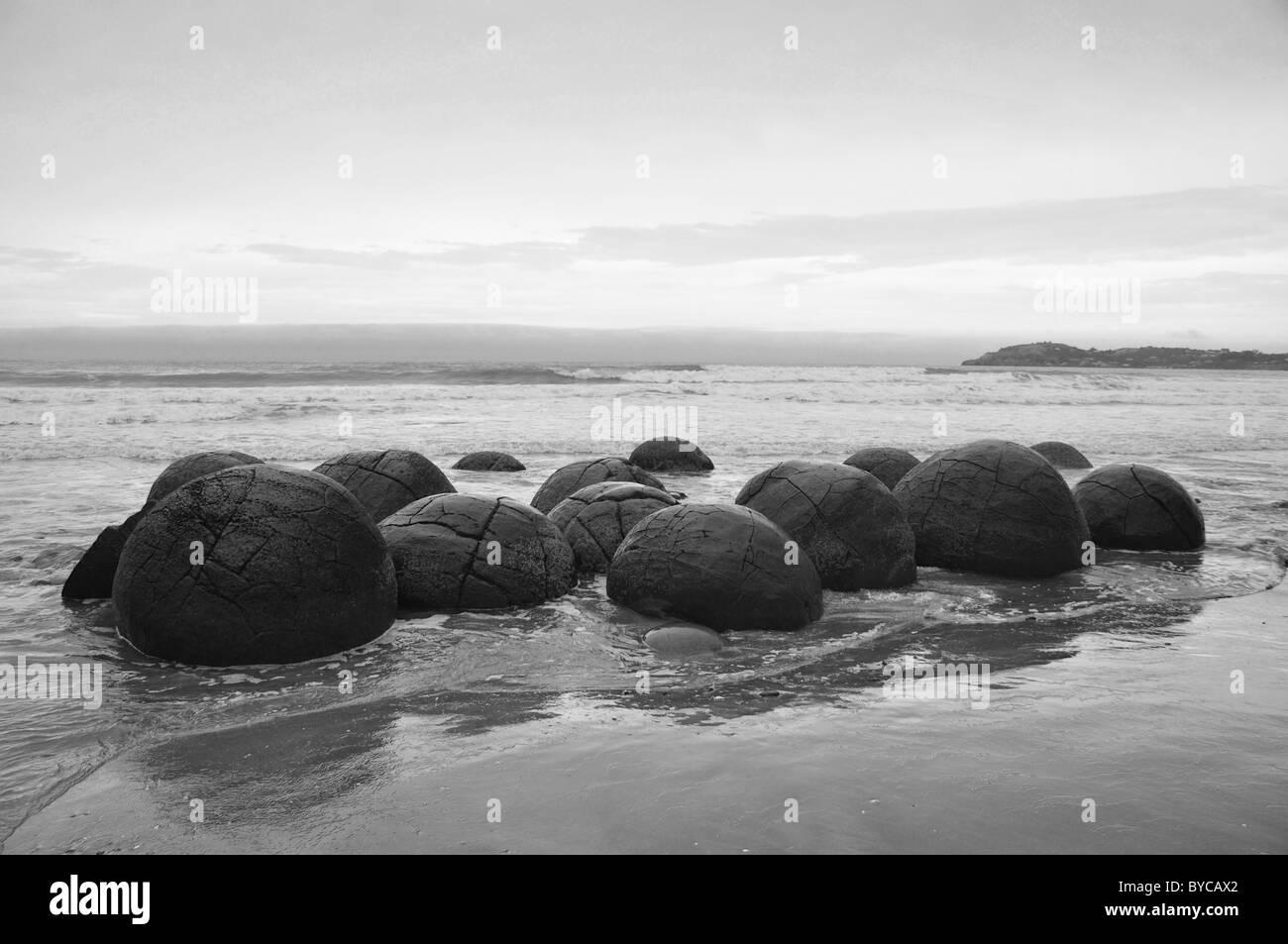 The Moeraki Boulders on Koekohe Beach, Moeraki, North Otago, Otago Region, South Island, New Zealand - Stock Image