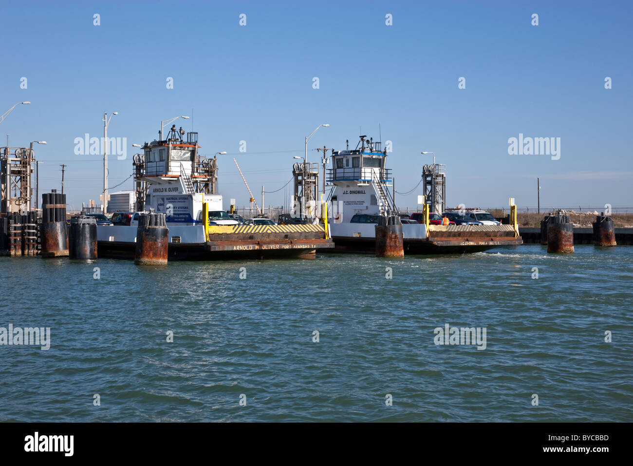 Ferries loading vehicles. - Stock Image