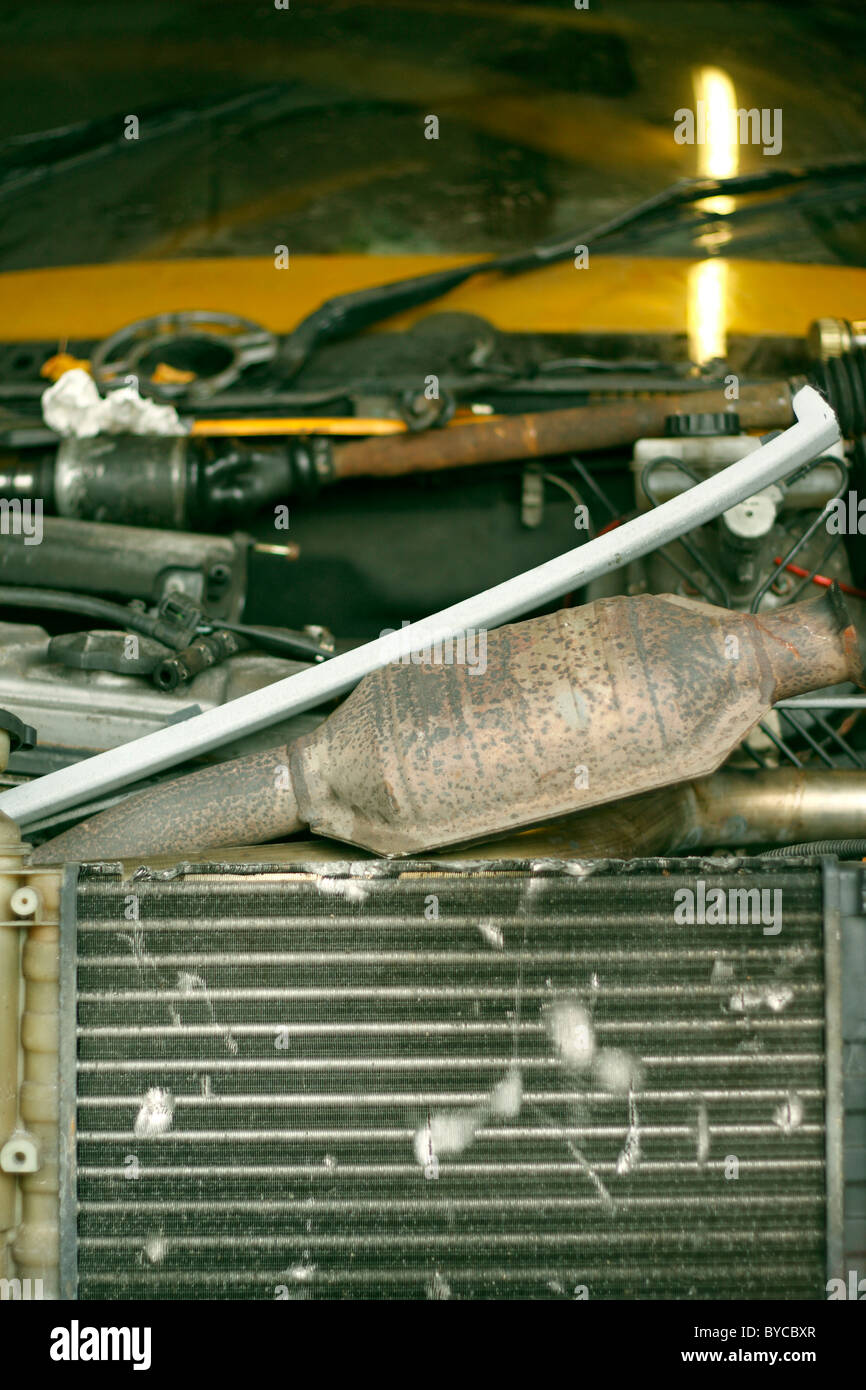 The Radiator Of A Car Inside A Garage And The Catalytic Converter