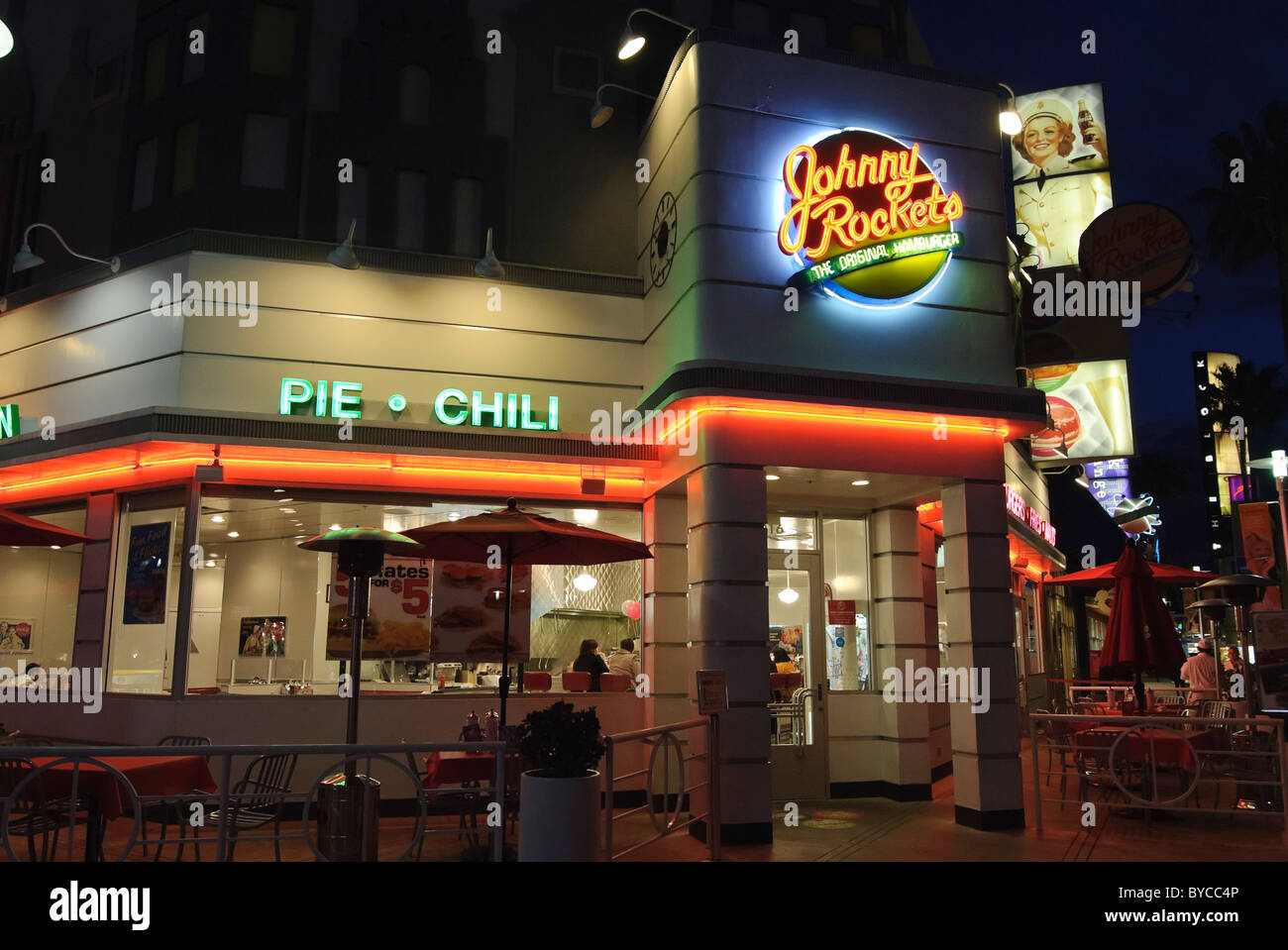 Johnny Rockets restaurant at night. - Stock Image