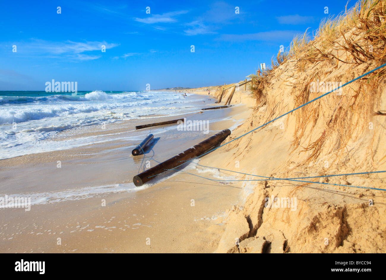Coastal erosion with fence posts washed away at Swanbourne Beach as a result high tides caused by Tropical Cyclone - Stock Image