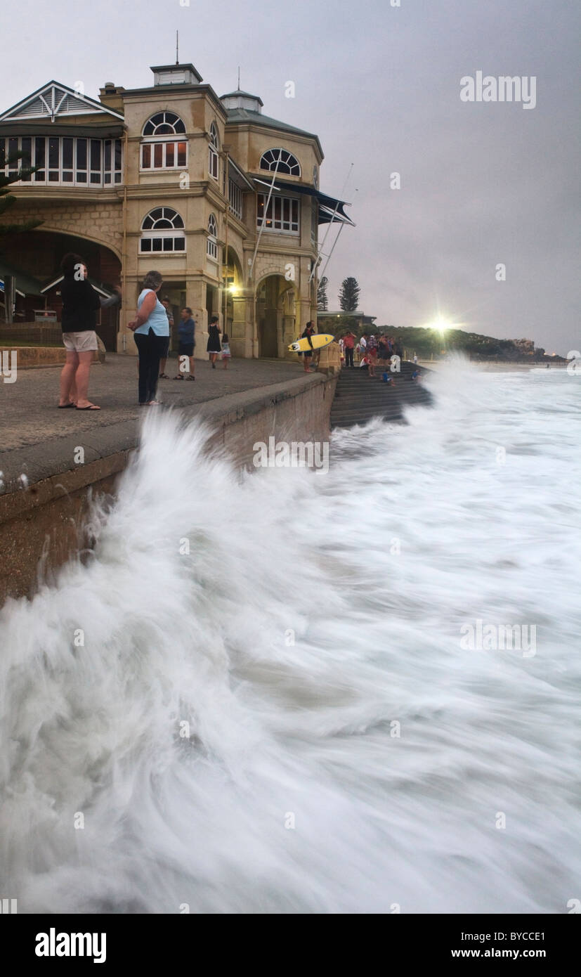 Exceptionally large high tide waves pound against the Indiana Tea Rooms at Cottesloe Beach as a result of Cyclone - Stock Image