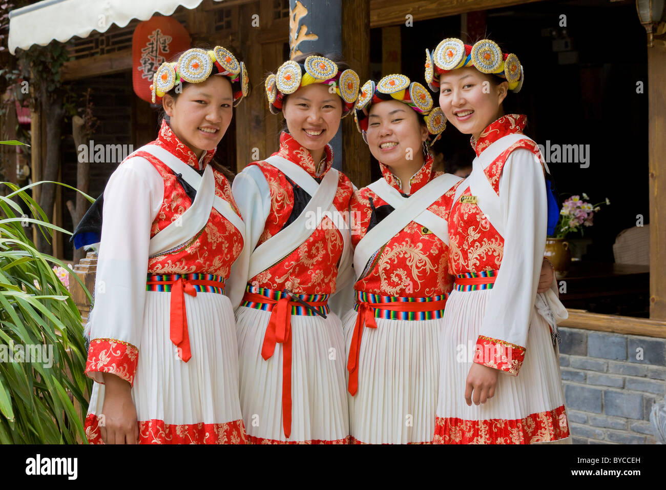 Four young Naxi women in traditional costume in Lijiang old town, Yunnan Province, China. JMH4761 - Stock Image